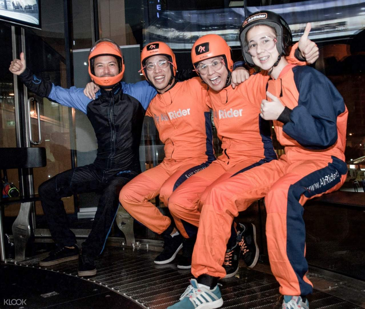 Indoor skydiving instructors with participants